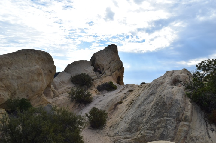 Climbing that was fun. Do you see a hiker resting in the rock?